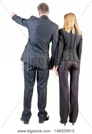 Back view of  pointing business team. young couple (man and woman) .  beautiful friendly girl and guy in suit together. Rear view people collection.  backside view of person.  Isolated over white