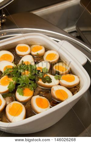 Stewed eggs or eggs and pork in brown sauce by Thai food