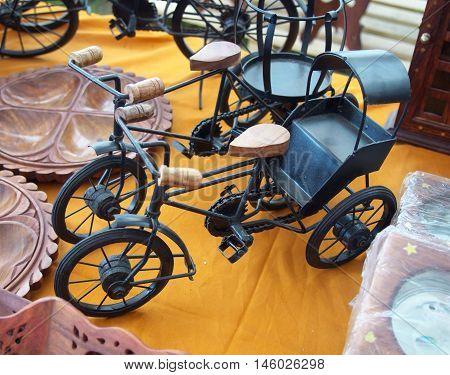 Souvenirs metal bicycles at the fair of Indian goods