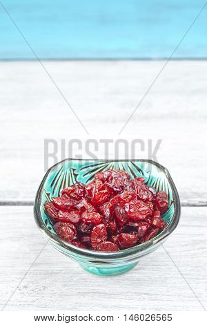 Dried Cranberries In A Bowl On Rustic Table.