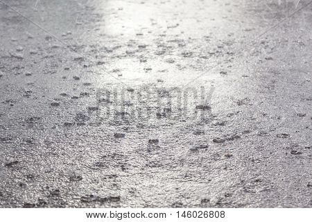 Rain flood background. Heavy rain drops falling on the ground.