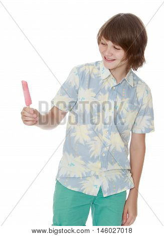 Portrait of a young man in shorts and a shirt with short sleeves. The young man is holding a ice cream. Close-up  - Isolated on white background