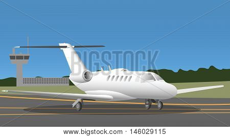 Business jet in the airport with traffic tower on the background
