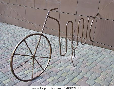Place for parking the bike in the form of an old bicycle