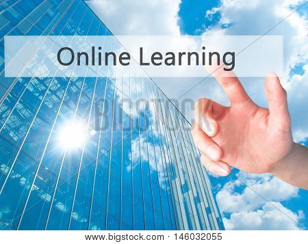Online Learning - Hand Pressing A Button On Blurred Background Concept On Visual Screen.