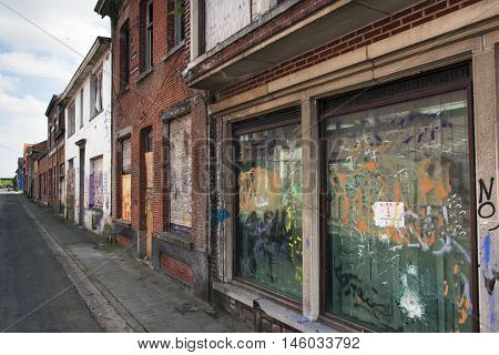 Street in ghost town Doel in Belgium