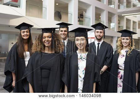 Group portrait of university graduates in cap and gown