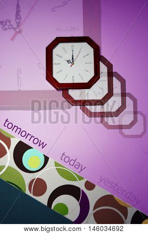 Yesterday today tomorrow sign in a conceptual image. Conceptual image of clock on the wall which symbolizes life.Image show what life is colorful but immediately recall how quickly it passes.Many transparent clock.Below a picture of colored circles and da