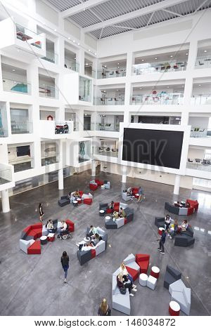 Modern university lobby atrium and study rooms, vertical