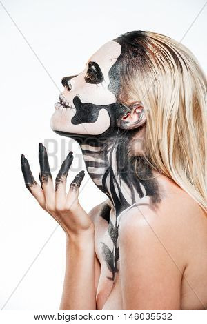 Profile of woman with intimidating halloween makeup over white background