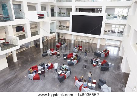 Modern university lobby atrium and glass fronted study rooms