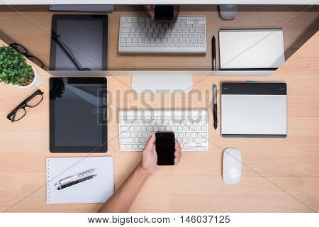 Top View Office Hand Working With Mobile Phone