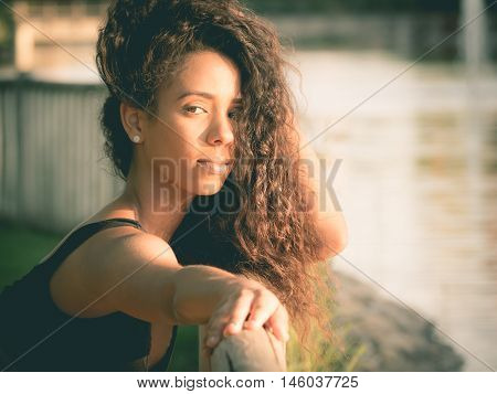 Latin woman looking at camera with outstretched hand