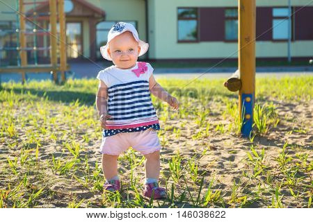 Little baby girl on public playground