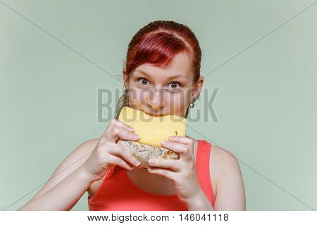 Girl Bites Cheddar Cheese