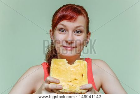 Young Girl Bites Cheese