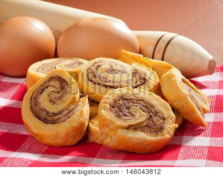 Pinwheel cookies with eggs shot over brown background. Horizontal shot