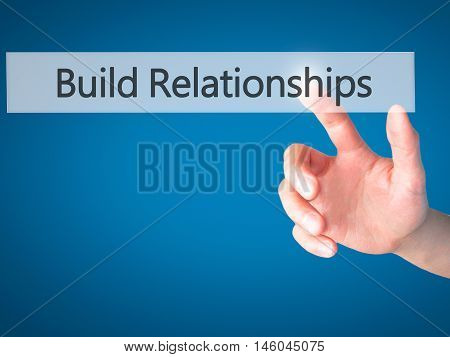 Build Relationships - Hand Pressing A Button On Blurred Background Concept On Visual Screen.