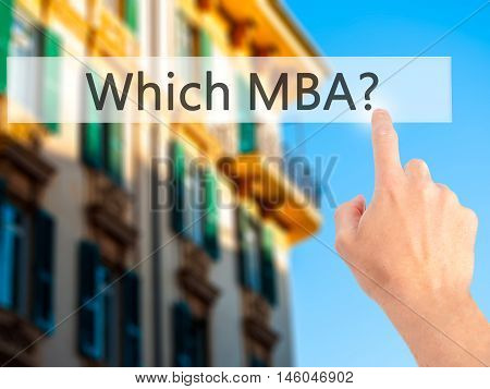 Which Mba? - Hand Pressing A Button On Blurred Background Concept On Visual Screen.
