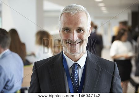 Portrait Of Male Delegate During Break At Conference