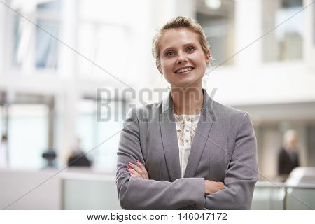 Head And Shoulders Portrait Of Businesswoman In Office