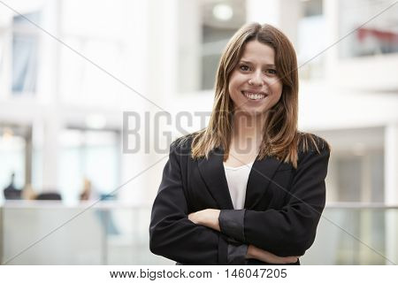 Head And Shoulders Portrait Of Young Businesswoman In Office