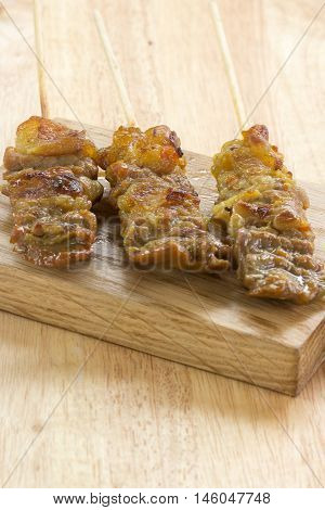Thai style grilled beef on wooden broad