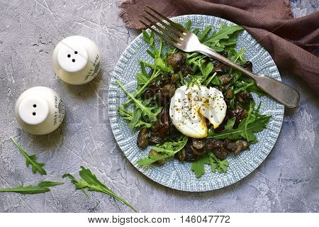 Warm Mushroom Salad With Arugula And Poached Egg.top View.