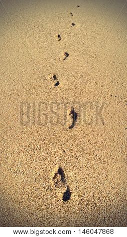 Human footprints in the sand natural vintage background