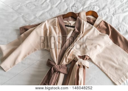 Clean bathrobe  on bed