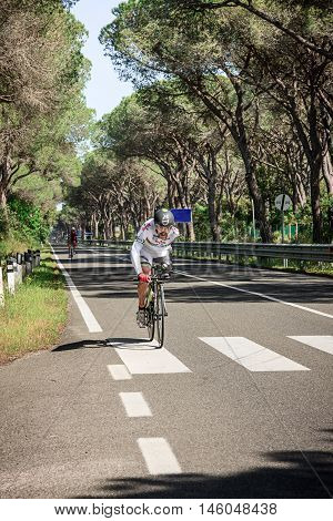 Grosseto, Italy - May 09, 2014: The cyclist without an arm and feet with the bike during the preparation to sporting event The 2014 IPC Athletics Grand Prix Italian Open Championships