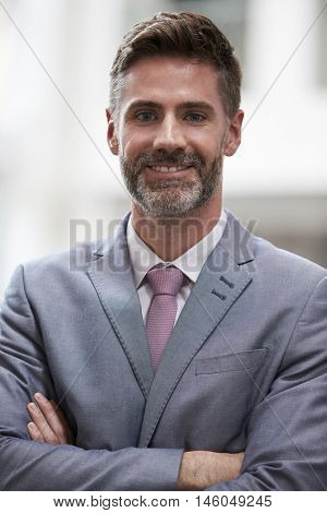 Head And Shoulders Portrait Of Businessman In Office