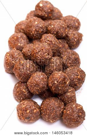 Chocolate balls with nuts isolated on white background