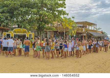 JERICOACOARA, BRAZIL, DECEMBER - 2015 - Young people queuing for party tickets at Jericoacoara Brazil