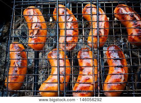 Pork grilled sausages for summer dinner. Selective focus