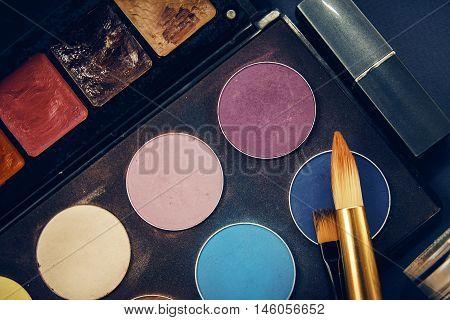 closeup female cosmetics makeup. brash with palette