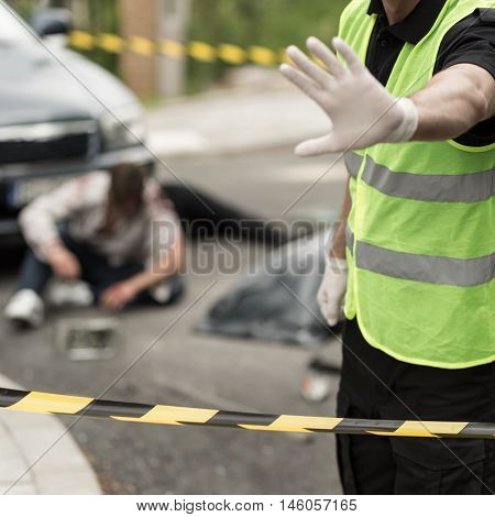 Image of policeman at car accident area