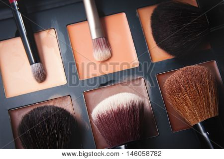 close up Makeup brushes and different rouges