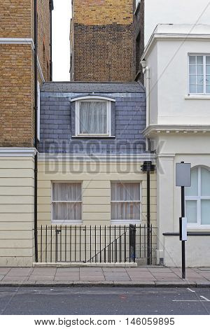 Small and Narrow House Squeezed Between Buildings