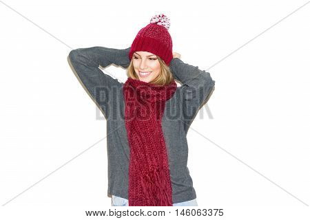 Beautiful young woman in red knitted hat, red scarf and gray sweater. Modern blonde female plus size model, smiling, wearing autumn and winter outfit. Isolated on white background.