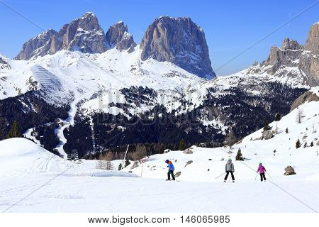 family is skiing in the european alps