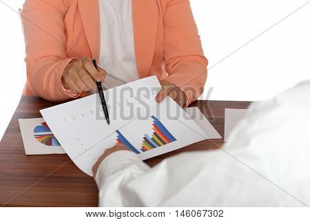 two people are working on a business meeting