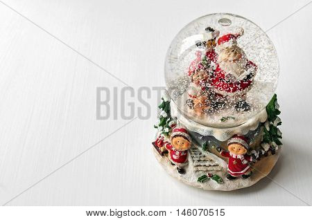 Snow globe with Santa Claus inside. Copy space available.