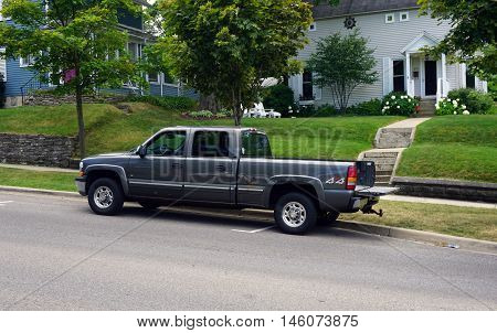 PETOSKEY, MICHIGAN / UNITED STATES - AUGUST 5, 2015: A Chevrolet 4x4 pickup truck is parked on Mitchell Street near downtown Petoskey.