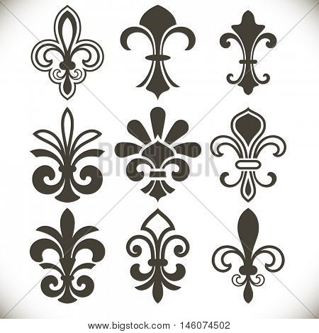 Black fleur de lis shapes vector set isolated on white background. Design elements for vintage designs.