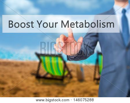 Boost Your Metabolism - Businessman Hand Pressing Button On Touch Screen Interface.