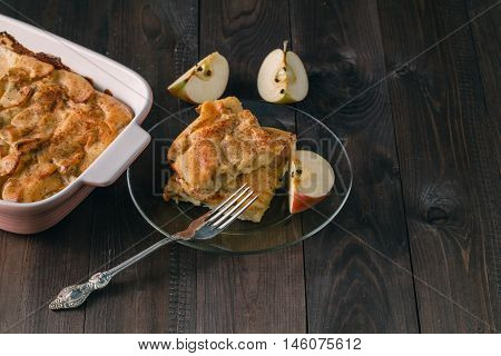 Apple Pie With Apple Slices And Crispy Crust On A Wooden Table. Homemade Desserts.