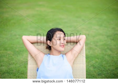 Girl Relaxing On A Recliner Chair