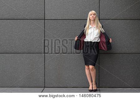 Stylish Professional Woman Opening Her Suit Jacket