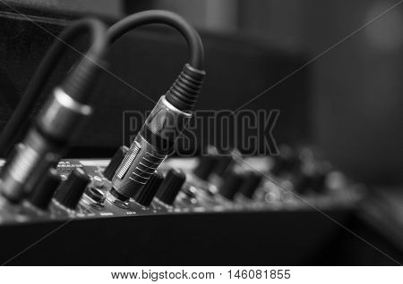 Closeup audio cables plugged into studio hardware, artistic equipment concept .